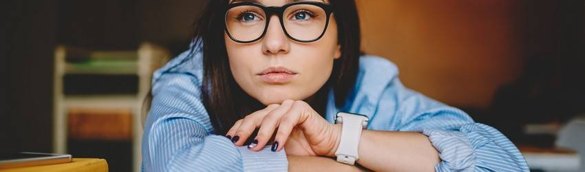 woman-with-glasses-on-in-deep-thought