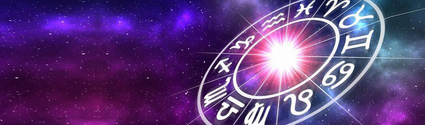 A zodiac wheel against a purple galaxy background.