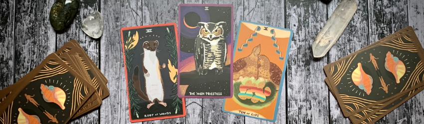 Three cards representing a past-present-future tarot spread.