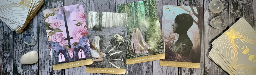 Three Swords suit Tarot cards sit on a wooden background.